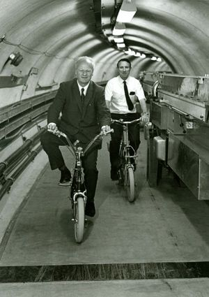 Hans Bethe and Boyce McDaniel bicycling in Cornell University's Wilson Synchrotron, c. 1968