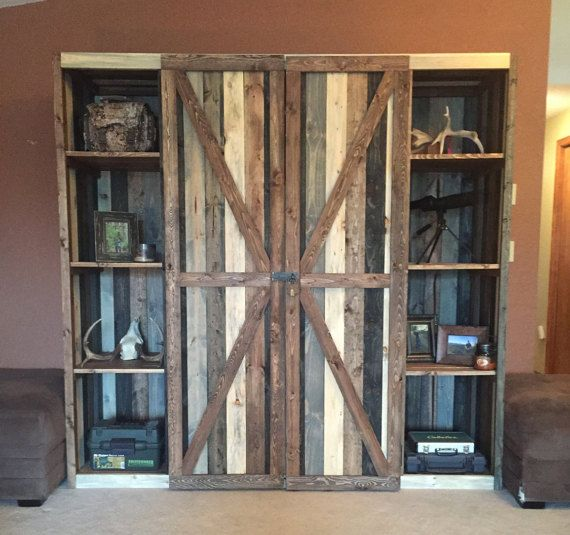 ***PLEASE READ BEFORE PURCHASING!!***  This rustic gun cabinet is a great way to store your guns and other accessories while also being a beautiful piece of decor in your home. This cabinet is made from pine that is uniquely stained these different colors to create a rustic reclaimed wood look. These colors are quite exquisite together.  This cabinet is very large, measuring 7x2x7. It is built in three pieces, due to its weight and size. It has plenty of storage, with shelving and two slots…