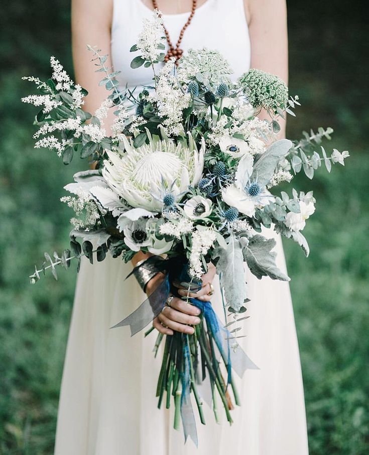 """greenweddingshoes: """" Pretty #bouquet full of white proteas, thistle, queen anne's lace, anemones + eucalyptus from today's editorial at @cedarwoodweddings {link in profile to see more indigo inspiration!} photog: @theulmers   design & flowers:..."""