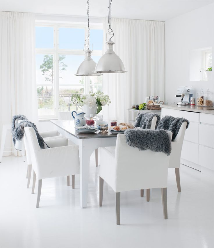casual white dining room table and chairs