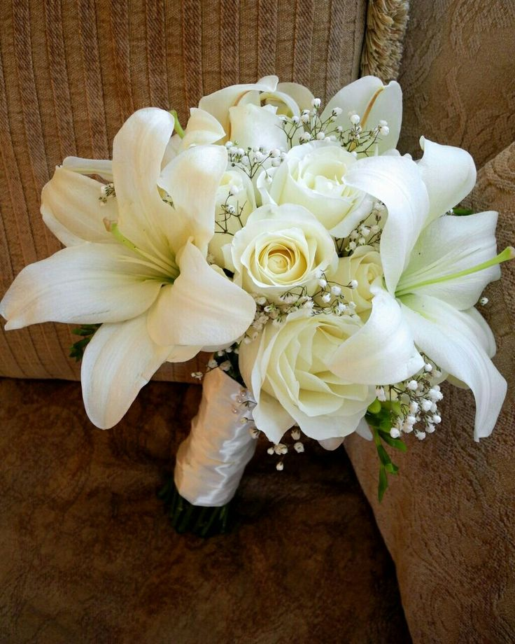 White Casablanca Lilies, White Roses, White Freesia, White Gypsophila Wedding Bouquet
