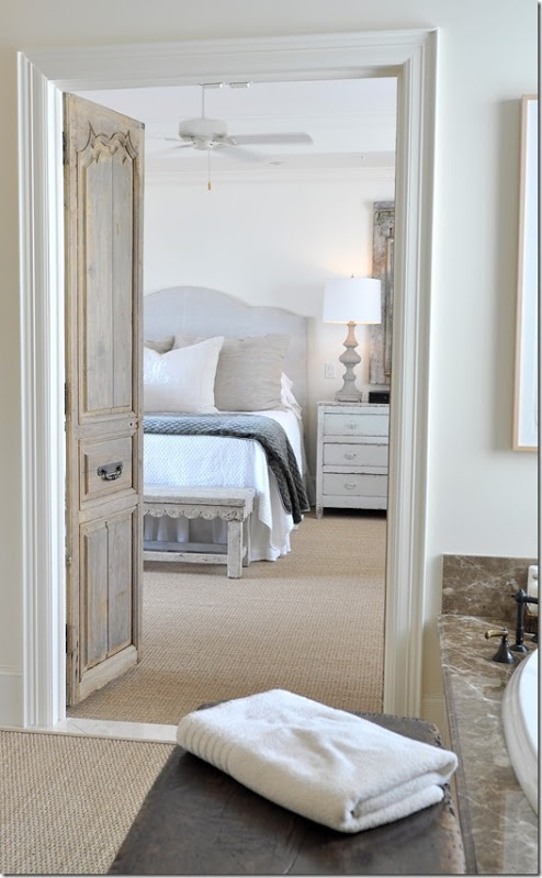 Use old doors as statement pieces (here in the master bedroom on the way to the en suite).