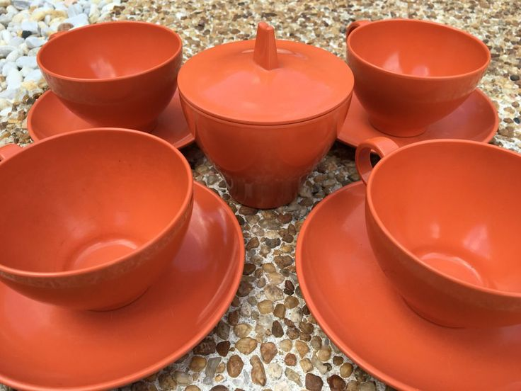 Four funky vintage melamine coffee/tea cups, sauces and lidded sugar bowl! Bright orange for midcentury Old Florida tropical kitchen!