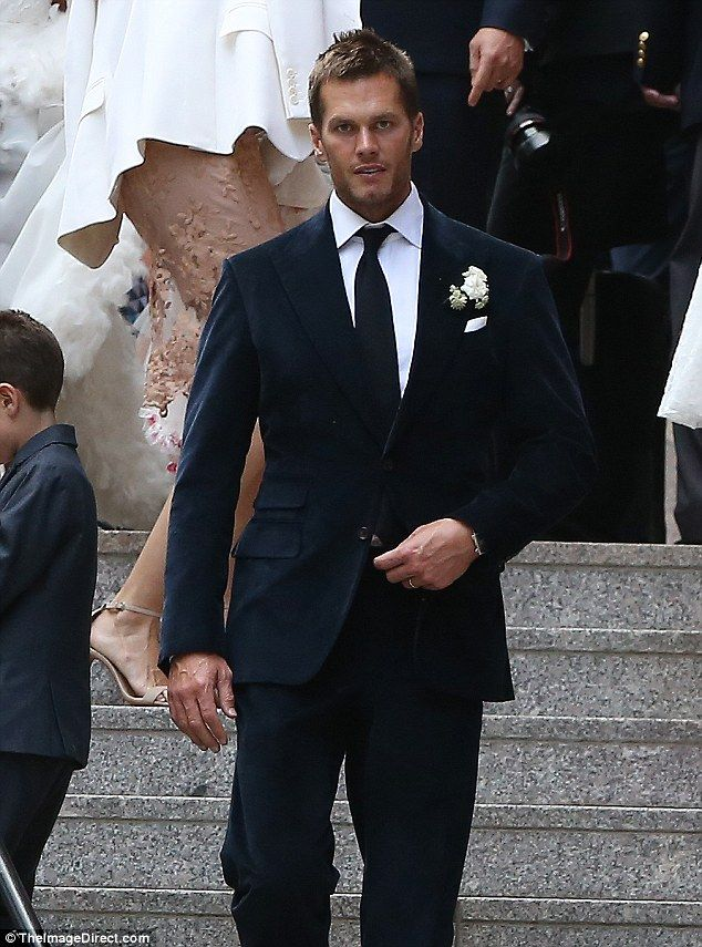 Patriots star: Quarterback Tom Brady looked handsome in a blue velvet suit...