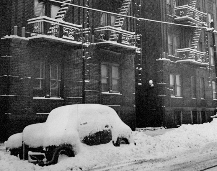 A light snowfall leaves a fire escape covered in snow -- and everything else on the street for that matter.