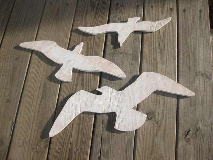 Seagulls beach decor sea birds wood wall art cottage coastal distressed shabby chic. $67.00, via Etsy.