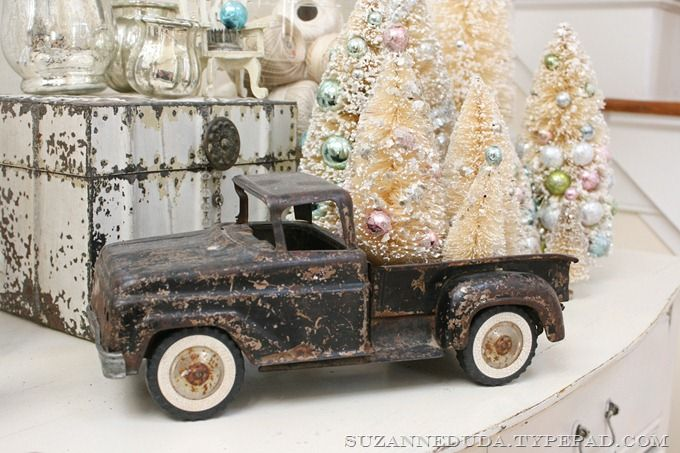 I just love these little bottle-brush trees... and the old toy truck that's hauling them!