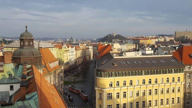 Afternoon in the Senovážné Square with the National Monument on the Top of Vítkov Hill Prague  #prague #travel #afternoon #senovaznenamesti #square #view #roof #vitkov #hill #national #monument #street #streetphotography #galaxys6
