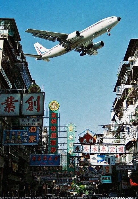 Kai Tak airport landing. The world busiest and most dangerous airport was closed in 1998. The noise from the passing planes must have been horrific. But what a view.