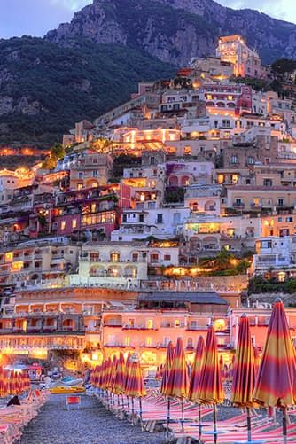 POSITANO, ITALY  From vibrant beach umbrellas and lush gardens to pastel homes built on cliffs overlooking the sea, this Amalfi Coast destination is the closest we've come to finding paradise.