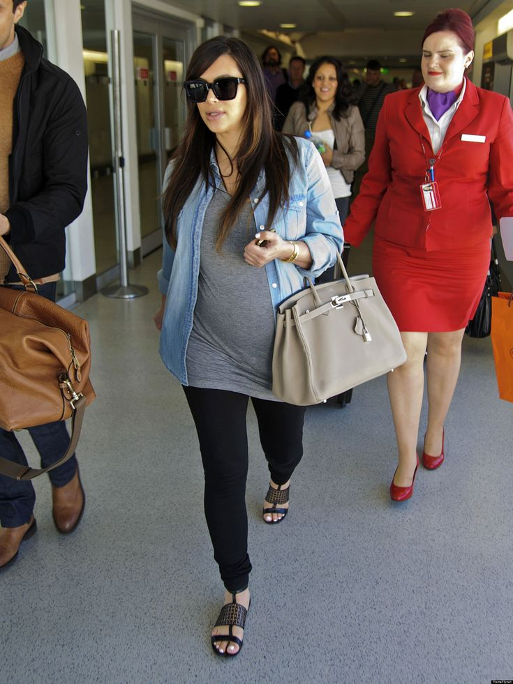 Kim K Keeps It Super Casual In Clingy Dress - But I'm not pregnant, just got a weight gain. HE HE!