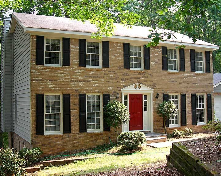 red front door on brick house | My Web Value