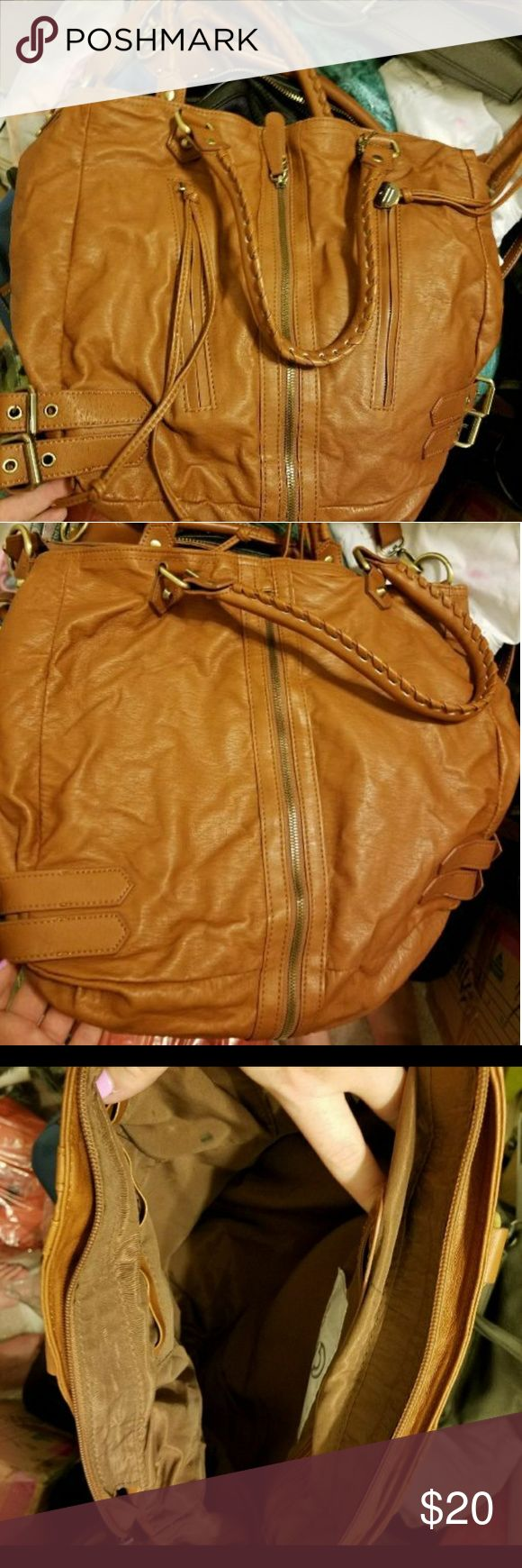 Big buddah brown purse Big buddah brown purse. Can be used as a shoulder bag or a crossbody. Long straps do come off. Has been used and has a lip gloss stain on one of the pockets on the inside. Big Buddha Bags Shoulder Bags
