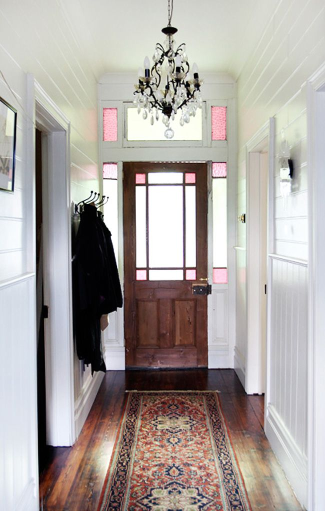 Love the paneling, the glass light, the rug and the vintage looking coat hooks - Chez Vanessa Partridge