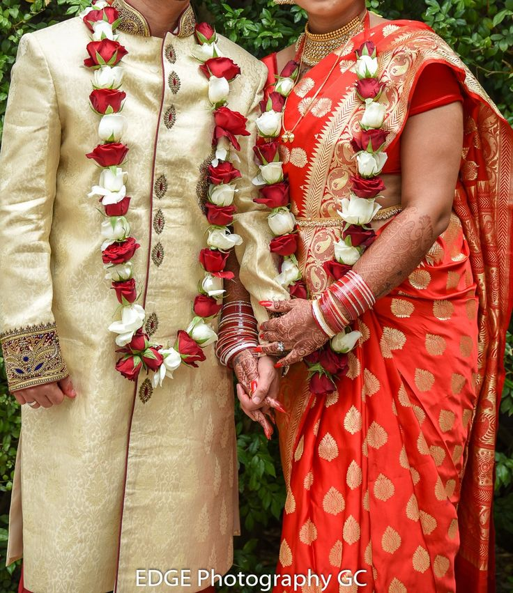 Traditional Indian wedding garlands, red and white roses.