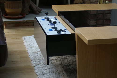 Double7 Arcade Table - GBP 3,499.00 »  A company called Surface Tension makes a video gaming table that doubles as a surprisingly attractive coffee table. In fact, it doesn't look like a video game cabinet at all. But when you slide out a drawer with video game controls on it, the piece is magically transformed.