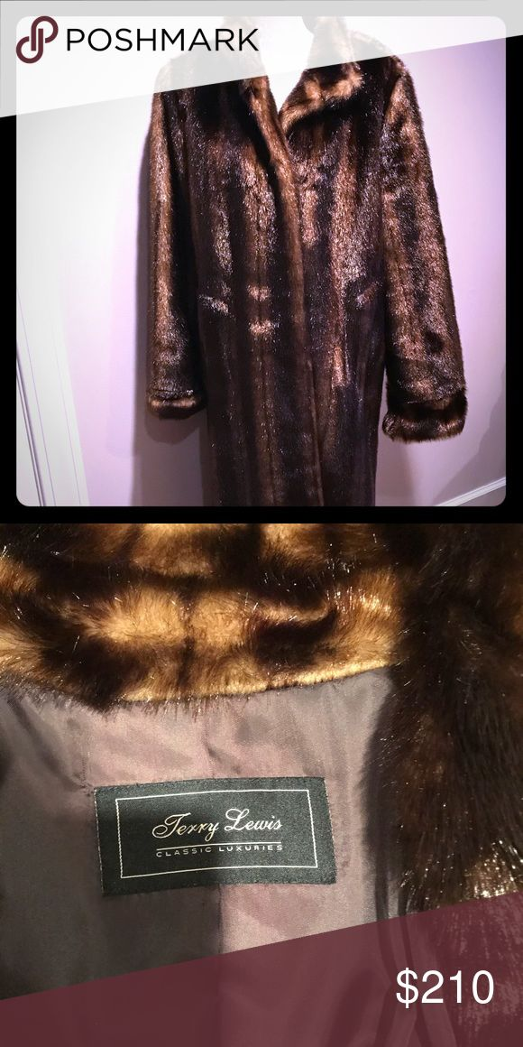 Faux Mink Coat Price drastically reduced! Must sell. Gorgeous faux mink full length coat. Warm and luxurious as well as animal friendly. Perfect for the holiday season. Size S but runs a little larger. NWOT. Never worn due to size. Jerry Lewis Classic Luxuries Jackets & Coats