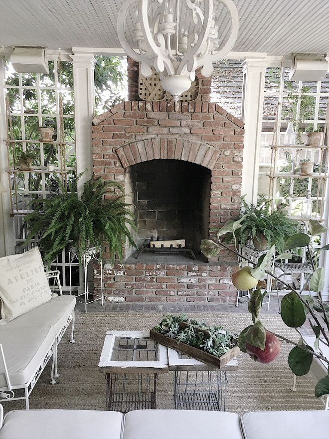 Farmhouse back porch brick fireplace and white and flea ... on Large Back Porch Ideas id=89885