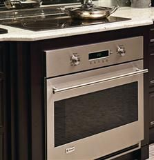 """Thanks to the GE Monogram 36"""" induction cooktop's shallow-depth configuration and integrated cooling system, you can install it above a Monogram single wall oven."""
