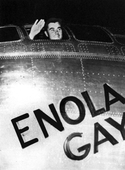 "Lt. Col. Paul Tibbets waves to the ground crew on August 6, 1945 as he pilots the B-29 bomber ""Enola Gay"" on its last bomb run. He flew from Tinian Island in the Pacific to drop the first atomic bomb on Hiroshima, Japan that help end World War II a few days later"