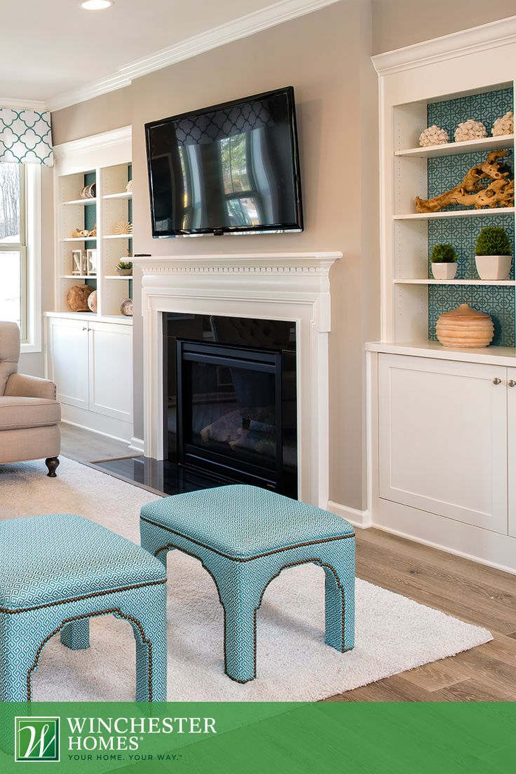 Filling The Built In, Recessed Shelves With Nature Inspired Decor And  Complementing With Turquoise Furniture Gives The Living Room In The Kelson  Model A ...