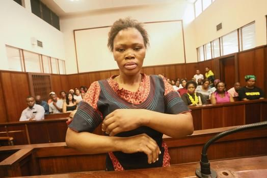 Durban - A woman accused of the murder of her boyfriend's ten year old son and the son's friend smiled as the case against her was adjourned - much to the ire of angry community members who packed the Durban Magistrate's Court on Monday.