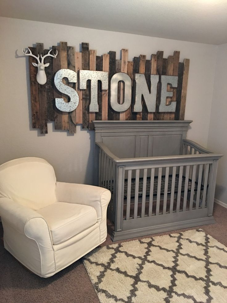 rustic wood pallet sign with galvanized metal letters above the babys