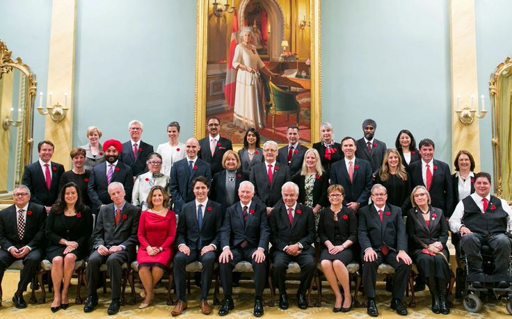 """Because it's 2015"" Justin Trudeau names Canada's first equal cabinet with 15 men and 15 women"