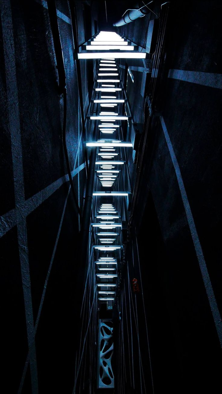 LIGHT PASSAGE is located in the narrowest alley of Chungjangro. It allows visitors to travel to another space, not through virtual portals but through their actual movement. Opening the door, visitors meet LED lines inspired by silk threads installed as if they are weaving buildings together. They guide them to the public parking lot and sometimes detect and follow visitors' movements. - Gwangju Biennale