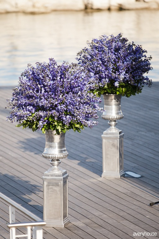 Euro Blue Delphinium dazzle the eye on Lake Michigan. Floral design by Fillitwithflowers.com