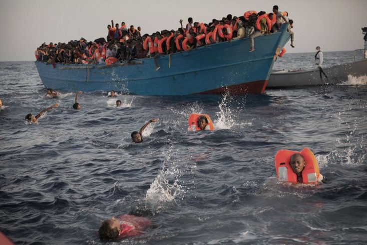 Migrants, mostly from Eritrea, jumped into the water from a crowded wooden boat as they were rescued off the coast of Libya, on Aug. 29, 2016. Thousands of migrants and refugees were rescued from more than 20 boats by members of Proactiva Open Arms NGO before transferring them to the Italian cost guards and other NGO vessels operating at the zone.