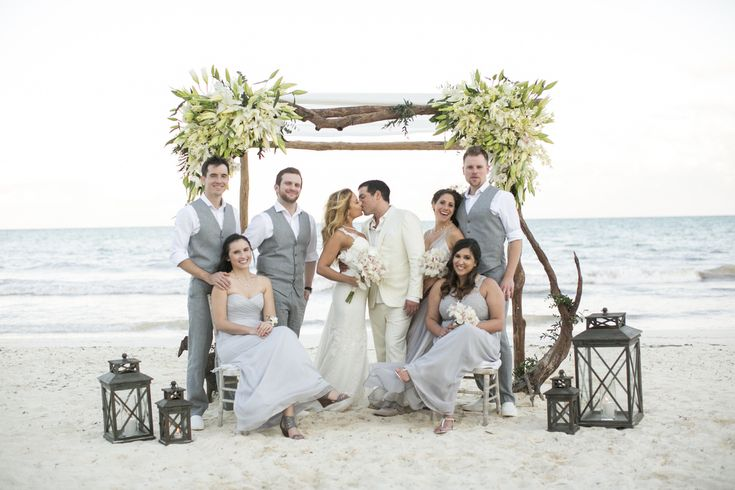 The Married Couple With Their Bridesmaids And Groomsmen Under Canopy By Aquadeco