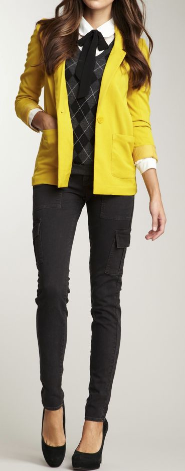 the yellow blazer with bow tie layered collar shirt with sweater pretty much rock....the cargo skinny pants with heels not so much..I'd totally go with van shoes for this look and maybe nerdy glasses