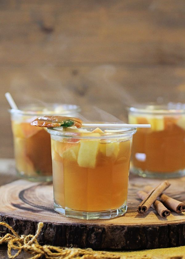 This caramel apple cocktail is perfect for fall. It's the perfect slow cooker drink to warm up guests!