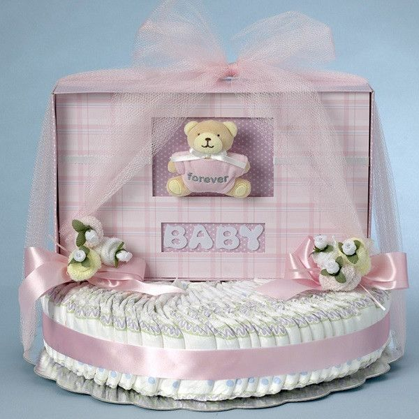 """Diaper Cake Description The main item in this gift is the Forever Baby Book™ Photo Album. The hard covered book holds up to 120 11"""" x 8.5"""" photo pages or scrapbook pages and includes 20 photo safe cle"""