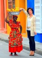 Sneaking a free sample, Chico's women's clothing photo shoot, Cartagena, Colombia