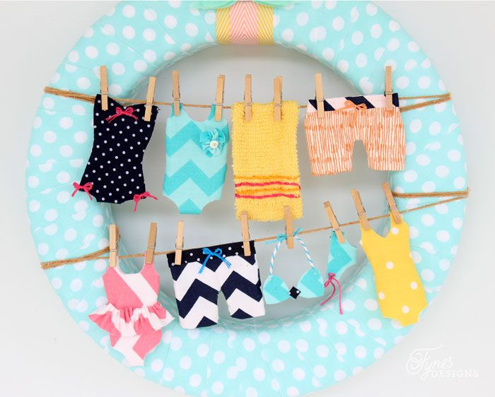 Create this easy and fun beach inspired summer wreath with a cute little clothesline.