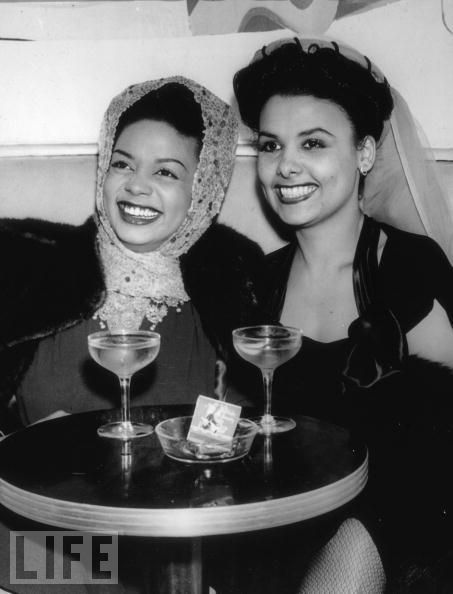 "Hazel Scott and Lena Horne enjoying a drink, circa 1940s or 1950s.      This photo is via LIFE magazine and the caption says this is ""circa 1934"" but that is wrong. Lena Horne was an unknown 17-year-old chorus girl in Harlem in 1934.    tumblr.com/vintageblackglamour"