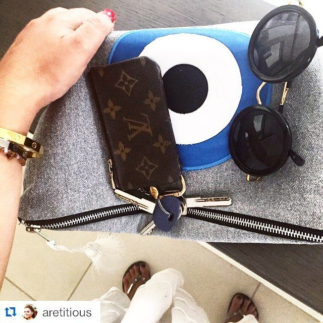 Good morning! Sunny days with our favorite clutch bag Christina Malle! Thank you @aretitious ! ・・・ Ready get set GO! @christina_malle_handmade_bags clutch @louisvuitton key holder, @lindafarrow shades @cartier @havaianas @jenspiratebooty summer dress #movienight #bliss #Greece. #handmade#bags#malle_bags#evileyeproject#eye#christinamalle_bags#clutches#handbags#sunmer2015#fashion#instafashion#vscofashion#style#streetstyle#Greece#lookoftheday#greekdesigner#madeingreece#summeringreece