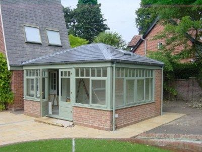 There is an old conservatory which has to be renovated however we hope to put a roof on it and make it more an all year family room yet keep the footprint as is to reduce costs. I like the colour green against the slate on this.