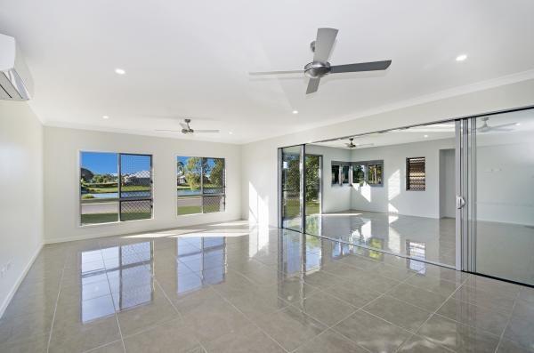Living Area. Alfresco. Lockable. Bifolds. Shutters. Tiles. Townsville's award winning builder. www.martinlockehomes.com.au