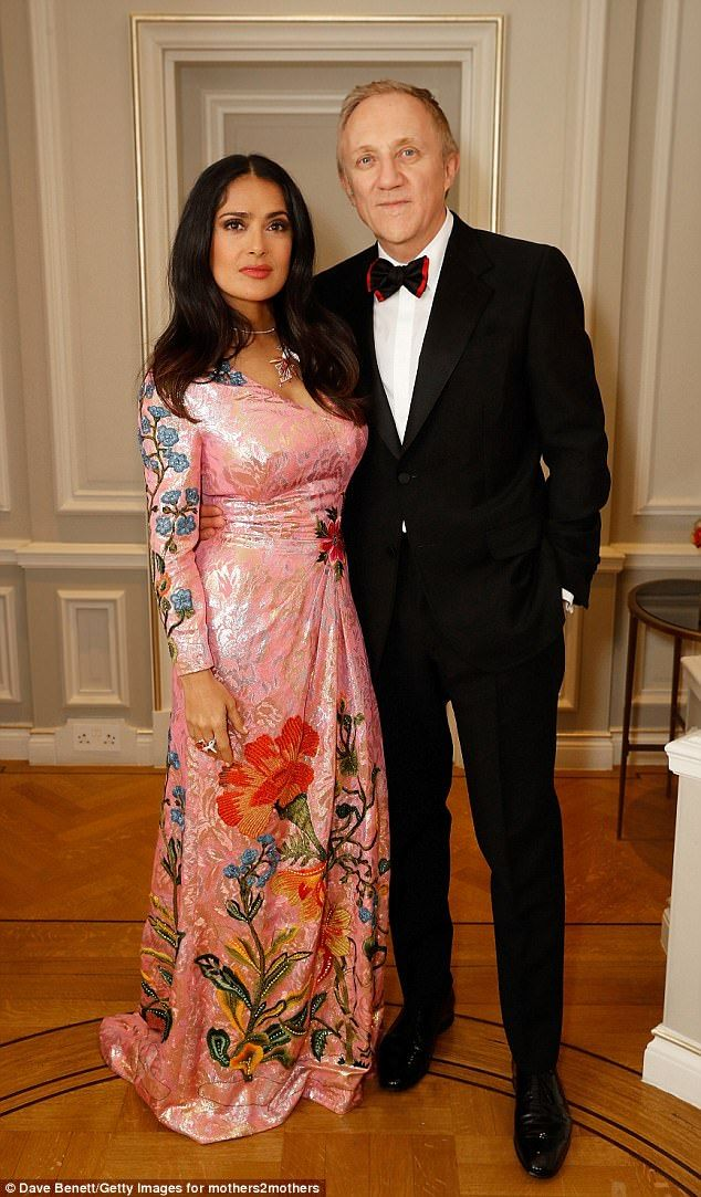 Stunning: Salma Hayek, 51, looked simply sensational as she stepped out on the arm of her husband of eight years Francois-Henri Pinault to host the mothers2mothers Winter Fundraiser on Wednesday night
