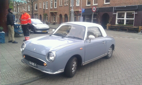 Funny Japanese retro styled sports car, a very rare Nissan Figaro, spotted in Amsterdam NL.    http://pinterest.com/treypeezy  http://twitter.com/TreyPeezy  http://instagram.com/treypeezydot  http://OceanviewBLVD.com