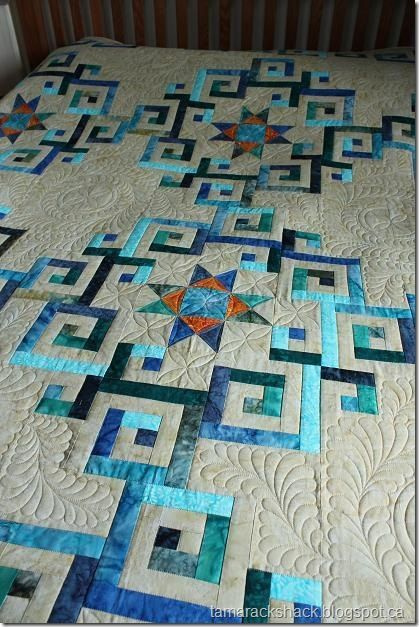 Great quilt log cabin... blue colors with beige backround realy pops the blues