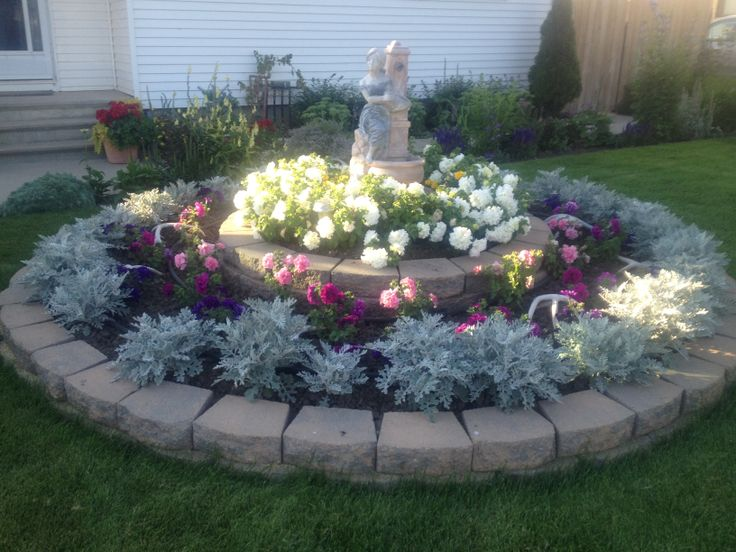 Circle flower garden in front of my house landscaping for House design with garden in the middle