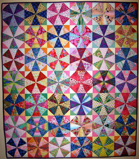 Kaleidoscope...when colors are placed carefully, overlapping circles result but it's all straight line piecing