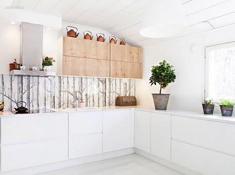 white kitchen + graphic wallpaper as backsplash