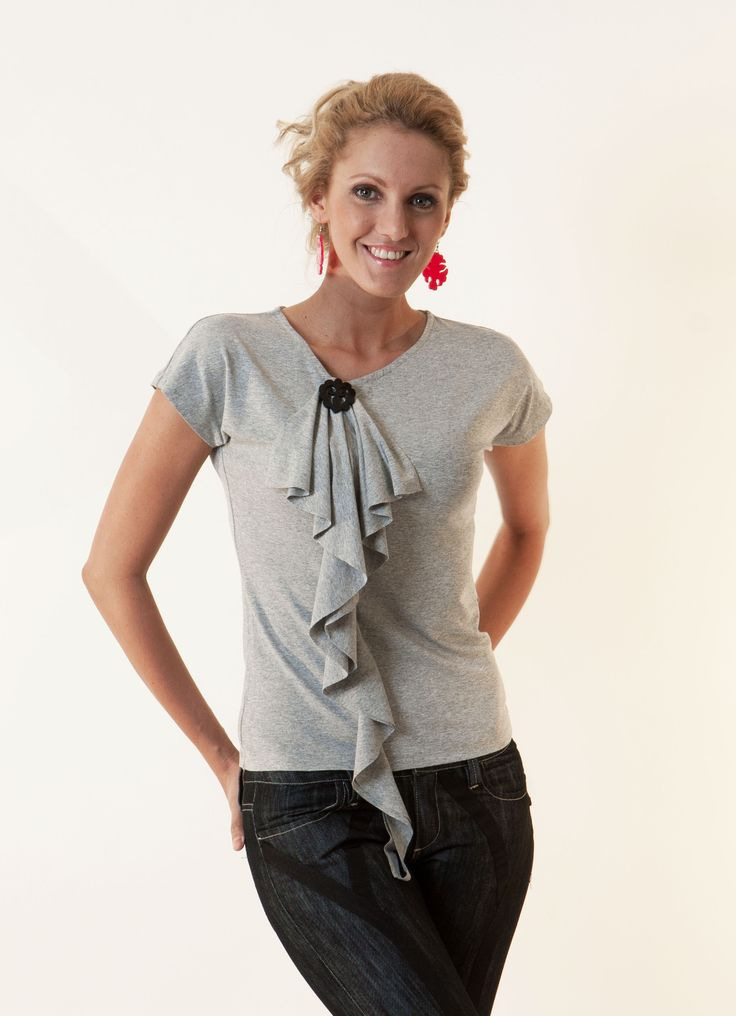 Waterfall top with brooch