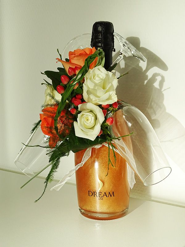 Een hele bijzondere Dreamline champagne met glazen en bloemdecoratie.