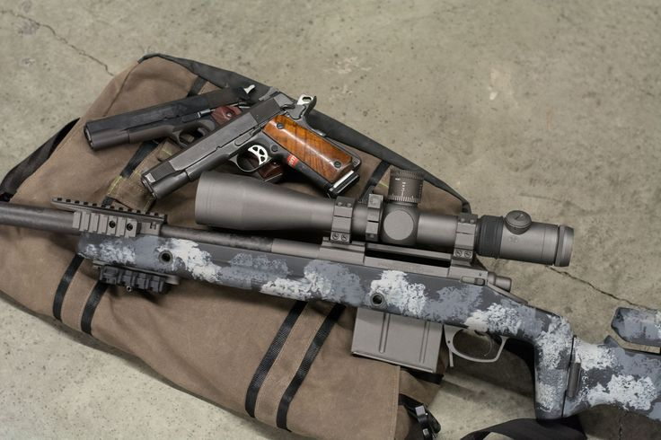 Spartan Precision .300 Win Mag sniper rifle, two Colt 1911's and an erathr3 Messenger bag. See more on groupcoalition.com.